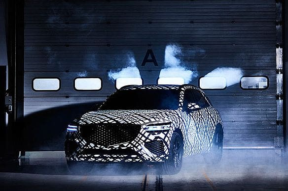 Genesis teases market with camouflaged GV70 luxury SUV